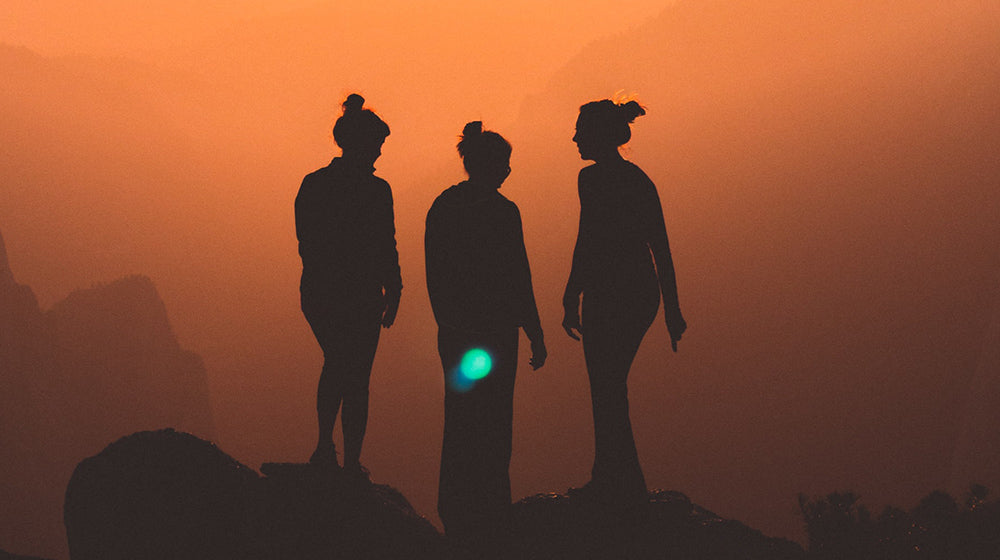 Image of people at sunset
