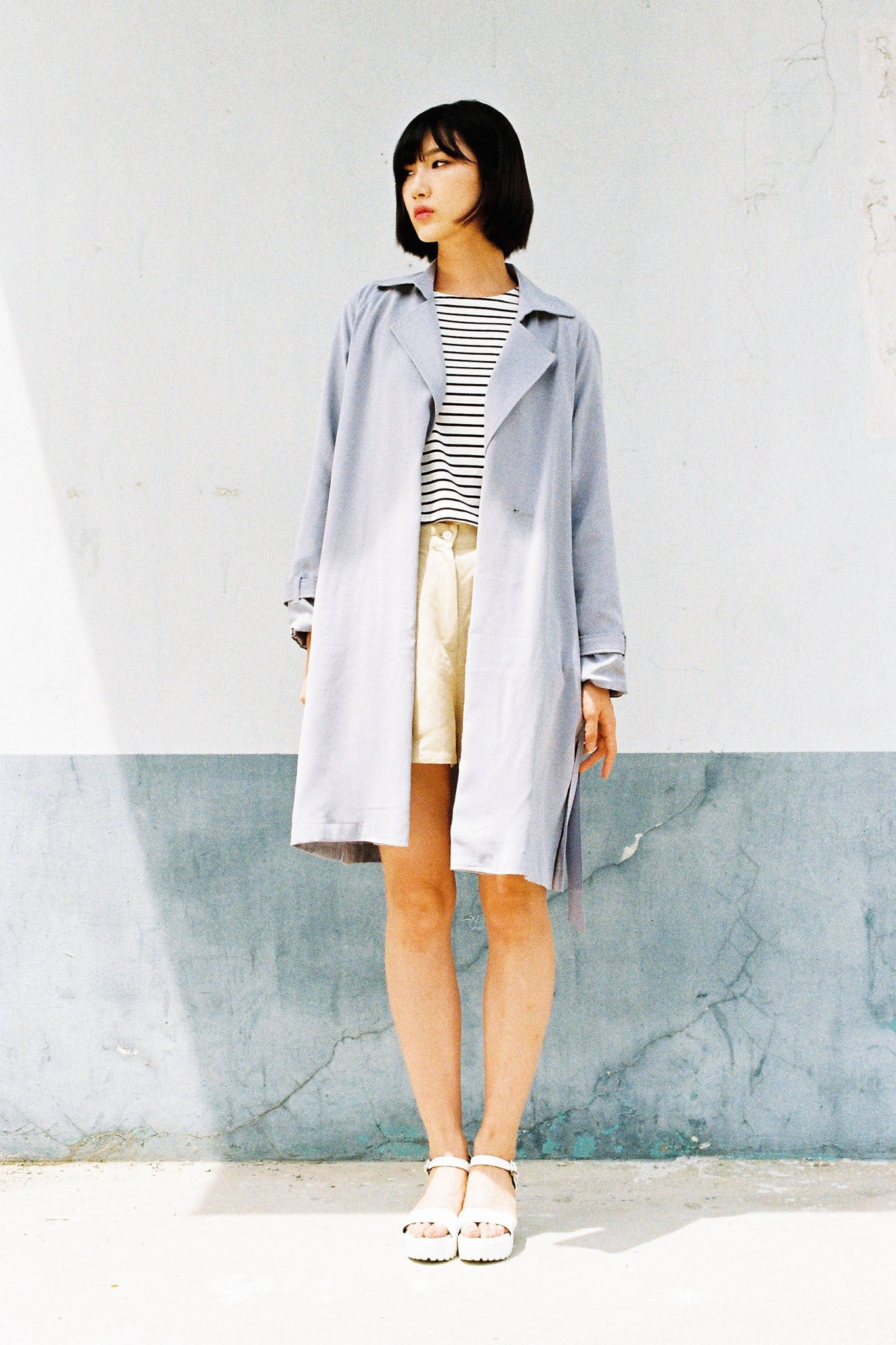 Street side slit trench-coat