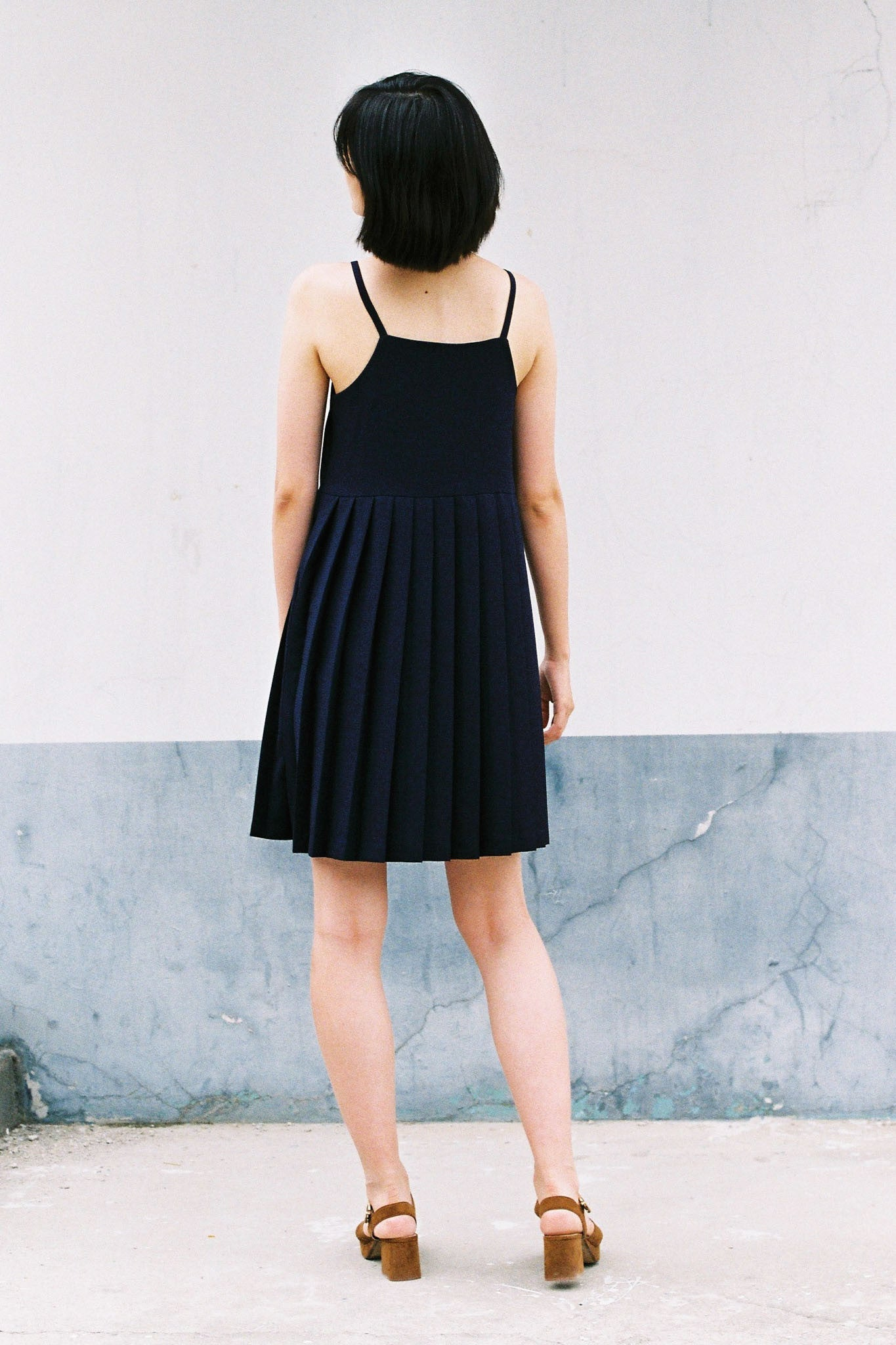 Hiro pleated apron dress