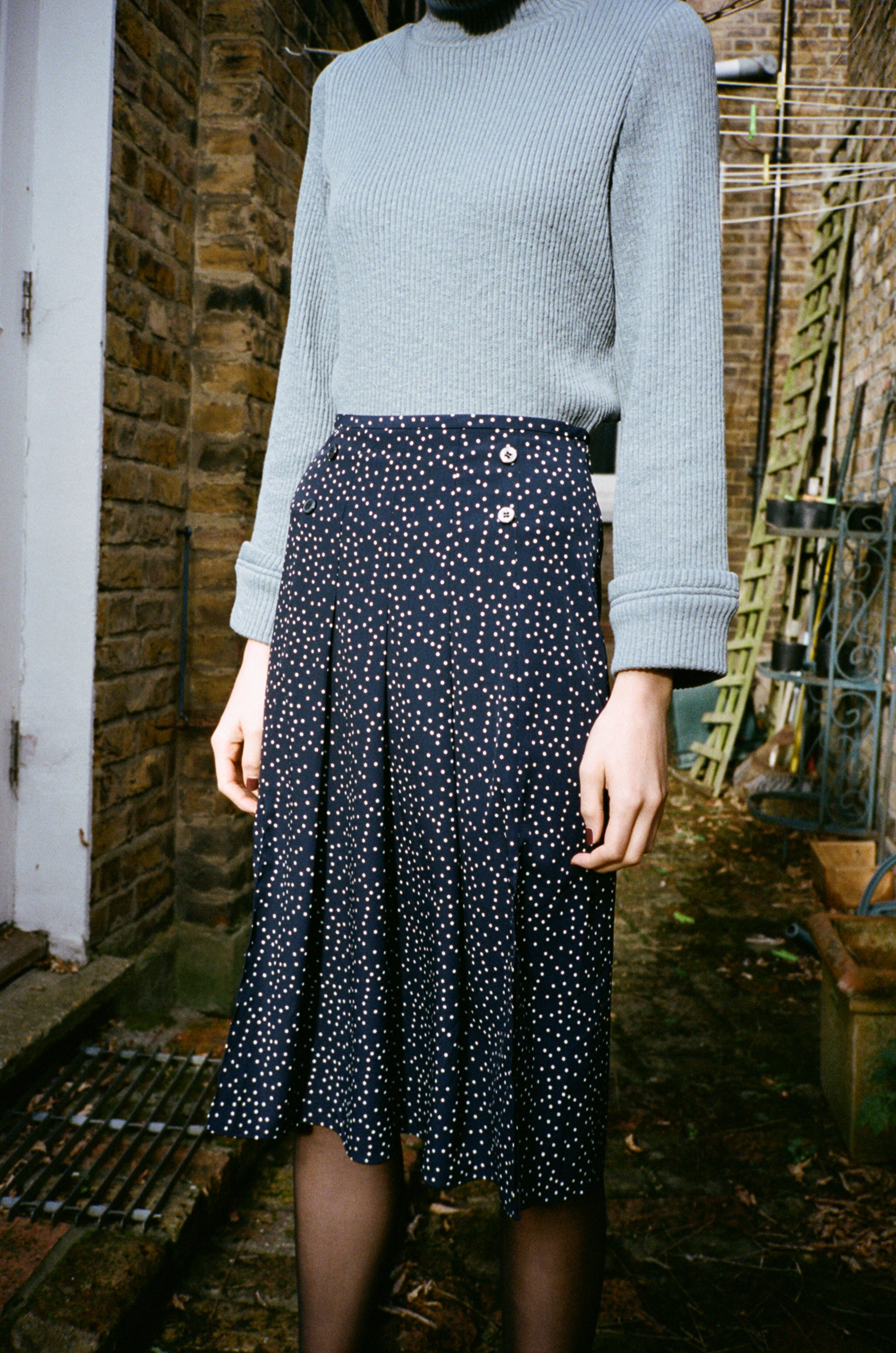 Billie dotted pleated midi skirt