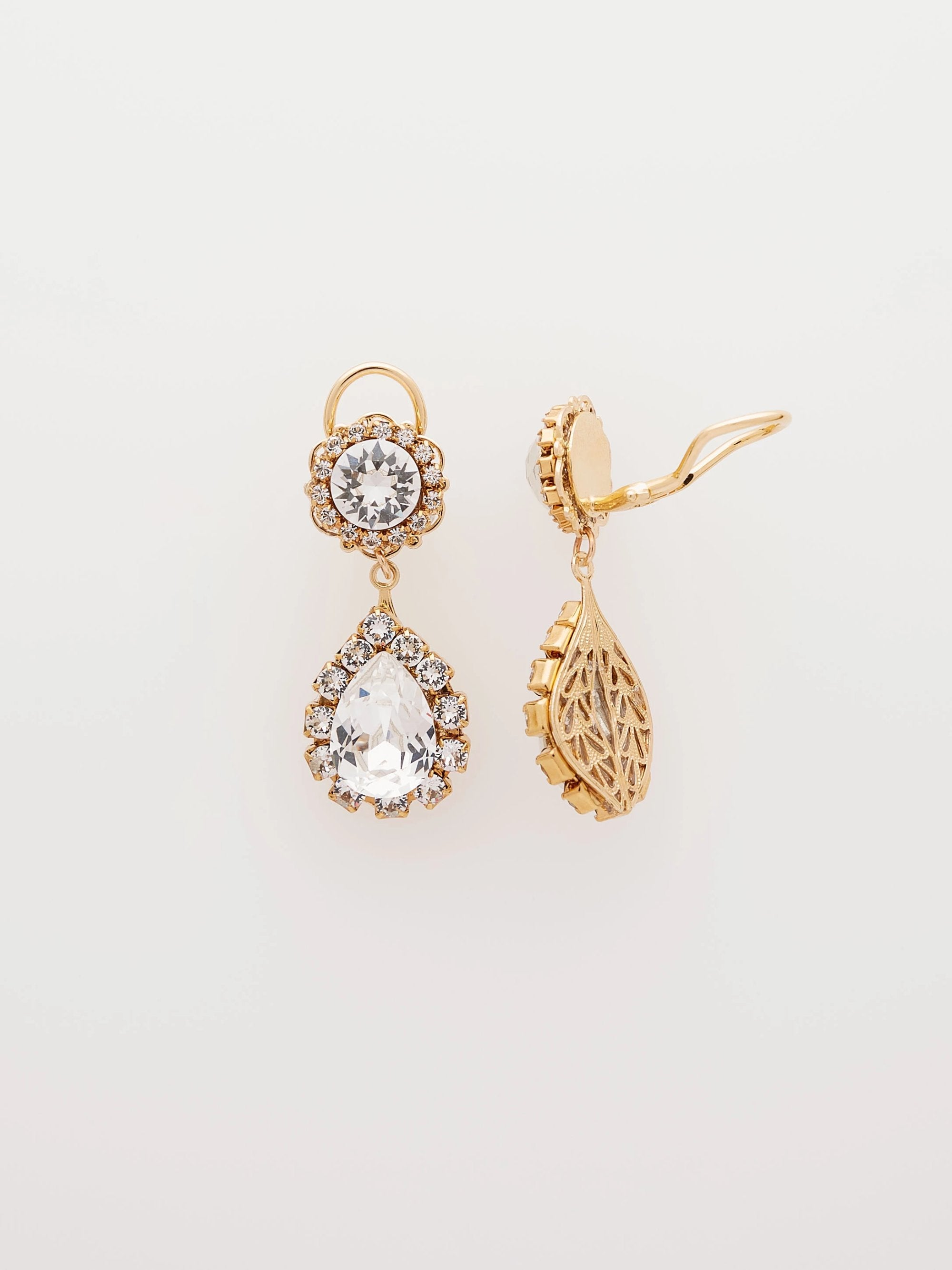 Gold double drop earrings with sparkling Swarovski crystals surrounded by crystal-set gold chain that dangle from gold clip-on earring backs. Made by Sara Gabriel.