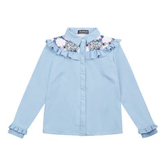 Elba denim shirt with frills. The shirt is made from light blue denim fabric with a printed yoke detail.