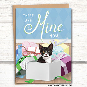 "Cat birthday card: ""These are mine now."" Tuxedo Cat in boxes."