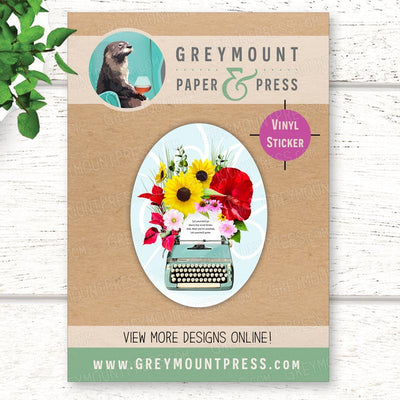 Vinyl sticker with a vintage typewriter with flowers and blooms coming out of the paper. Vinyl vintage typewriter laptop sticker.