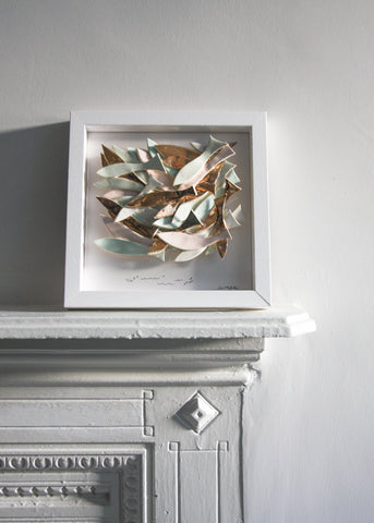 School of Fish, soft pastel with gold lustre , sculptural wall tile