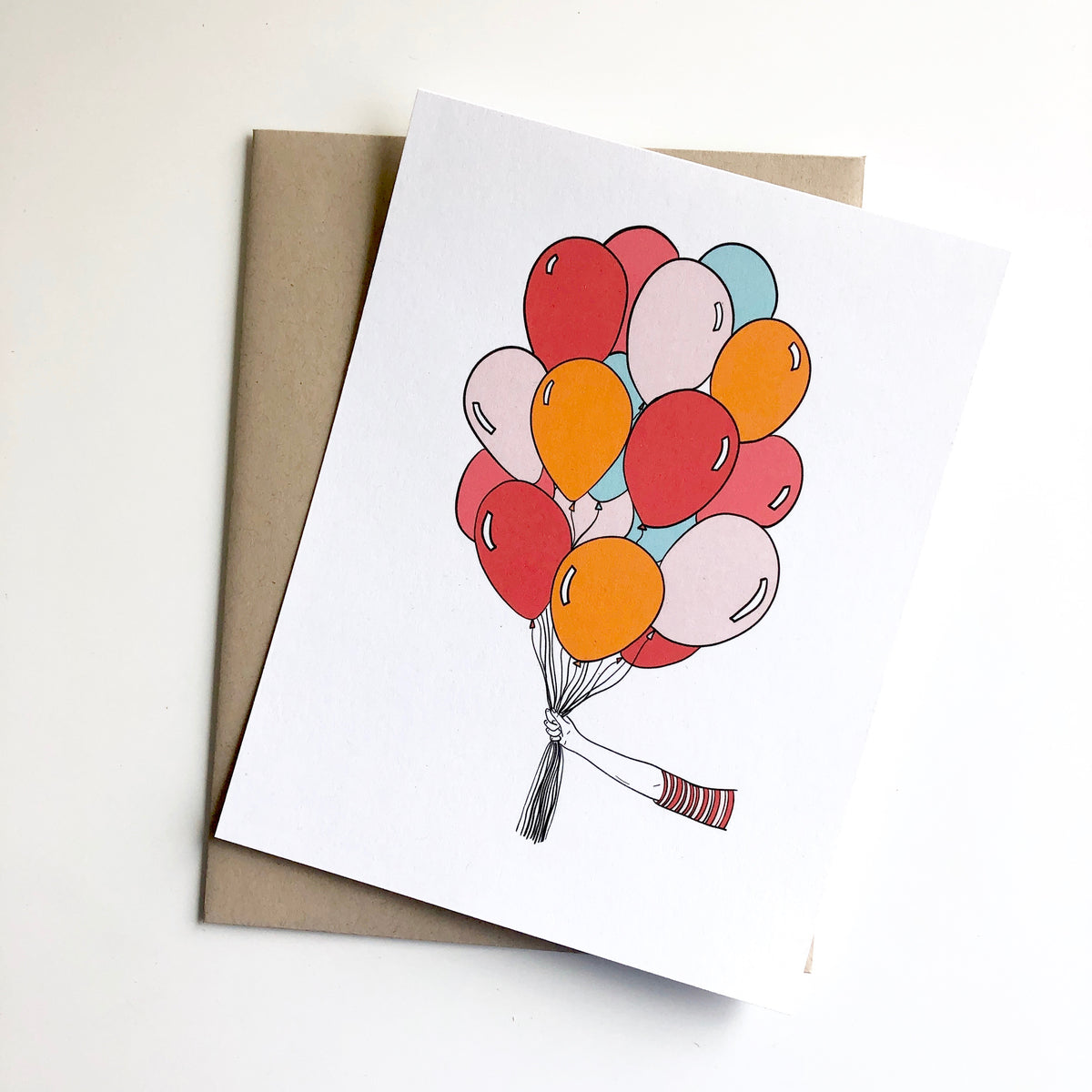Hand Holding Balloons Birthday Card