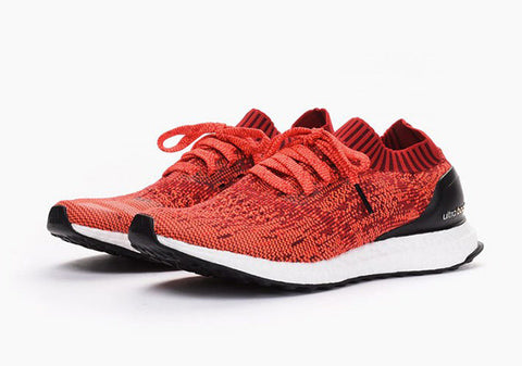 adidas ultra boost uncaged solar red black