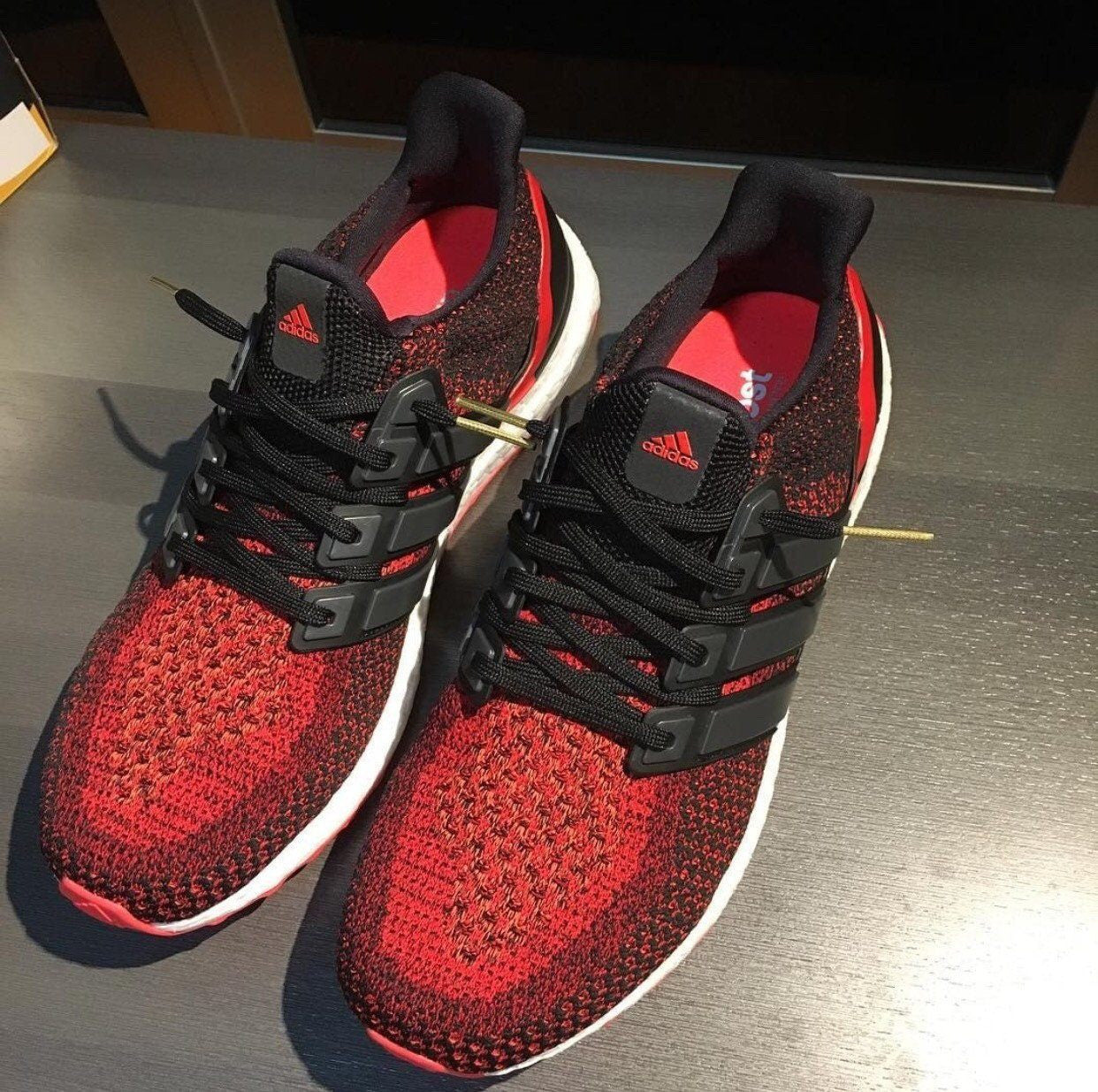 4a5c7b1c6 ... flat thin ultra boost basics flat laces og black with gold tips aglets