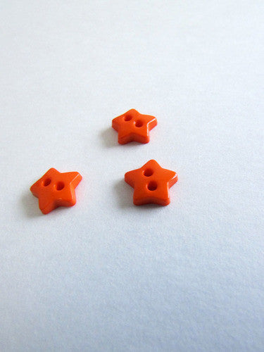 Bouton étoile orange de 1cm / Little orange star button 0,4''