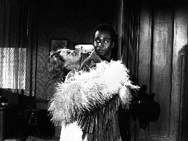 Blazing Saddles Lady wearing Feather Scarf hugging Man Scene Excerpt from Film Premium Art Print