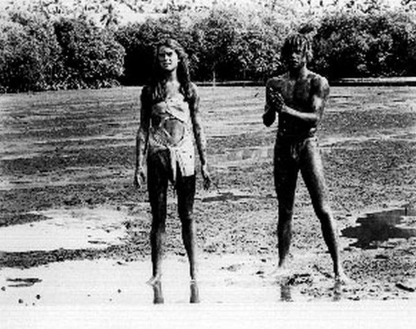 Blue Lagoon Man and Woman Covered with Mud Scene Excerpt from Film Premium Art Print