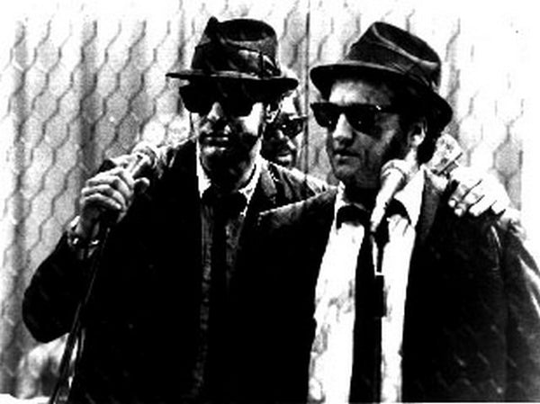Blues Brothers with Two Men standing with a Microphone in Black Suits Premium Art Print
