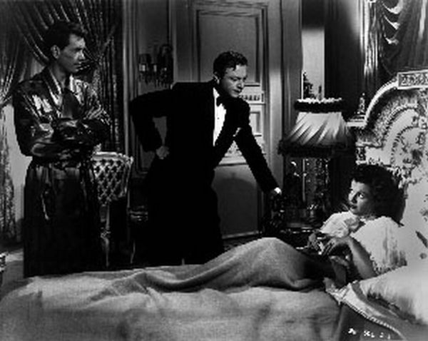 And Baby Makes Three Two Men Talking with Woman on Bed Premium Art Print