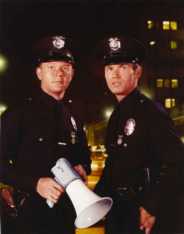 Adam-12 Holding Megaphone in Police Uniform High Quality Photo