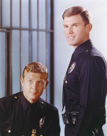 Adam-12 posed with Police Officer Uniform Near a Cell in a Movie Scene High Quality Photo