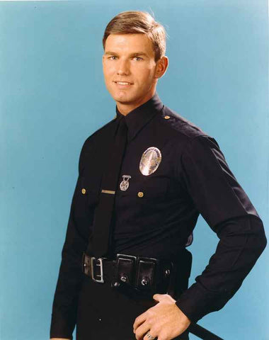 Adam-12 Posed in Police Uniform with Light Blue Background High Quality Photo