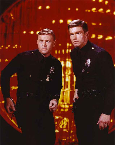 Adam-12 Posed with his Partner Inside the Building in a Movie Scene High Quality Photo