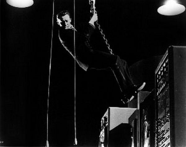 To Trap A Spy Hanging in Chains wearing Black Suit Premium Art Print