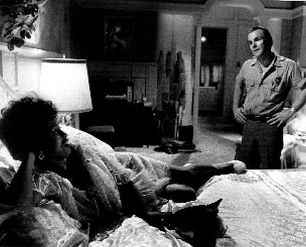 Liberation Of LB Jones Woman Lying on Bed While Talking To a Man in Black and White Premium Art Print