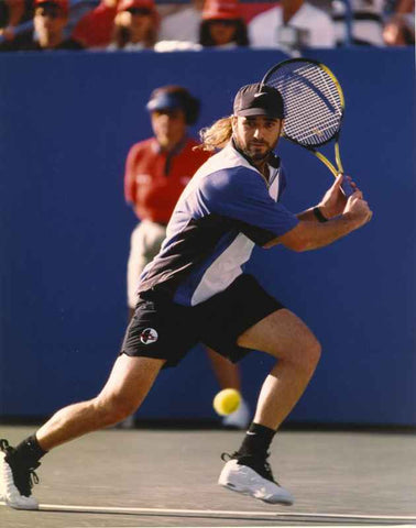 Andre Agassi Playing Tennis in Hat High Quality Photo