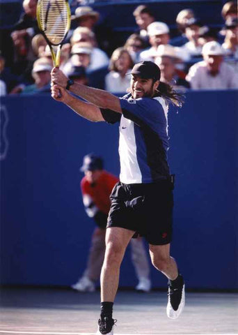 Andre Agassi Shows His Jack Knife Shot in Tennis High Quality Photo