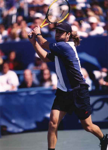 Andre Agassi Hitting with His Jack Knife in a Tennis Match High Quality Photo