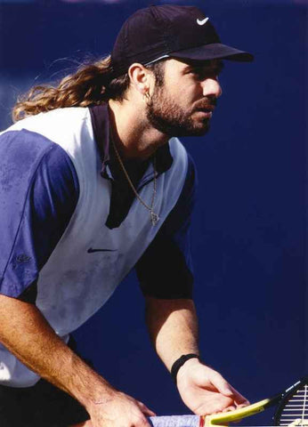 Andre Agassi Ready to Receive a Serve on a Tennis Match High Quality Photo