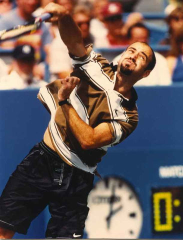 Andre Agassi Hitting with a Smash on a Tennis Match High Quality Photo