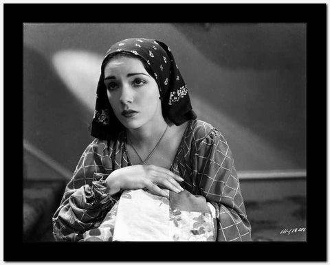 Lupe Velez Posed in Checkered Dress with Black Scarf on Her Head High Quality Photo