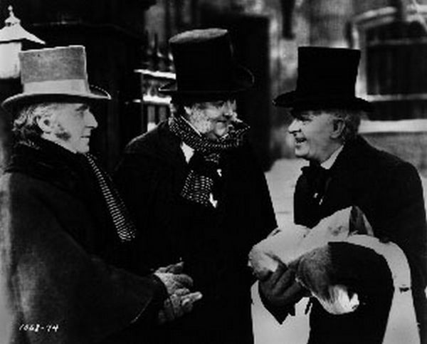 Christmas Carol Movie Scene Of Three People Talking in Black Suit with Hat Premium Art Print