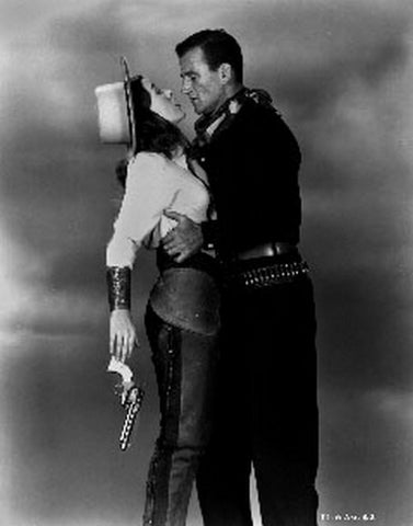 Tall In The Saddle Lady Holding a Gun and Hugged by a Man Premium Art Print
