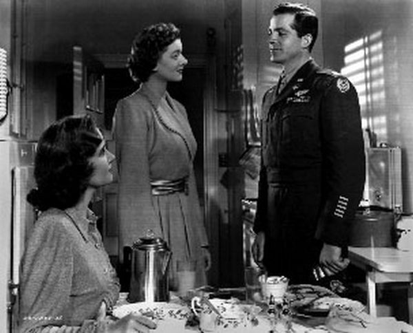 Best Years Of Our Lives Movie Scene Woman in Long Sleeve Dress Talking to a Military Officer in Decorated Uniform Premium Art Print