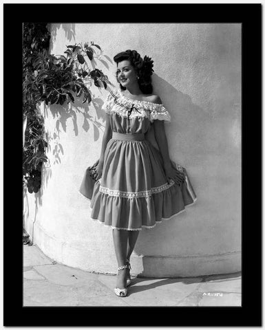 Ann Rutherford Leaning on the Wall while Holding Her Skit High Quality Photo