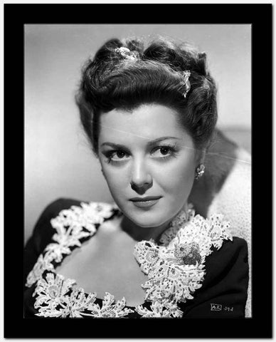 Ann Rutherford Looking Away From the Camera wearing a Black Dress High Quality Photo