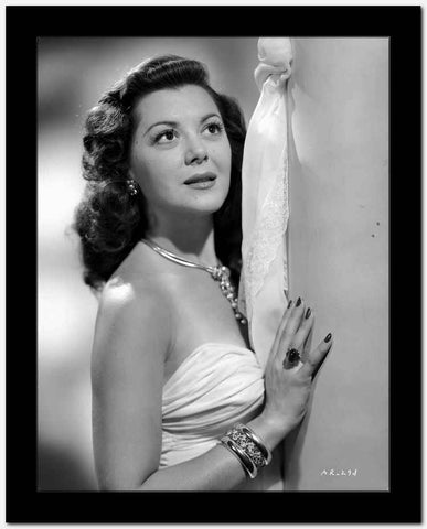 Ann Rutherford Leaning on the Wall wearing a Strapless White Dress High Quality Photo