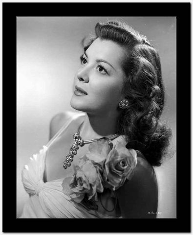 Ann Rutherford Facing Up wearing a Dress With Floral a Flower on the Shoulder High Quality Photo