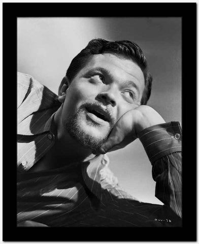 Orson Welles Leaning Head on Hand in Stripes Polo High Quality Photo
