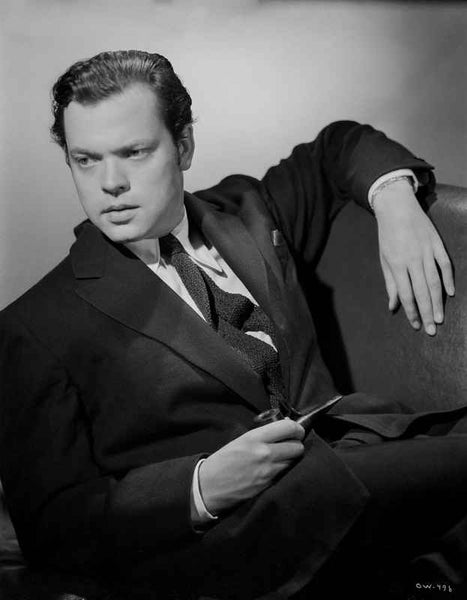 Orson Welles Reclining in Coat and Tie Premium Art Print
