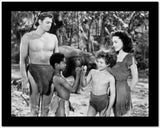 Johnny Weissmuller standing with Two Kids and a Woman in a Movie Scene High Quality Photo