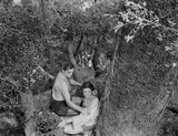 Johnny Weissmuller Rescuing a Girl in a Classic Movie Scene Premium Art Print
