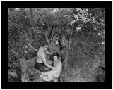 Johnny Weissmuller Rescuing a Girl in a Classic Movie Scene High Quality Photo
