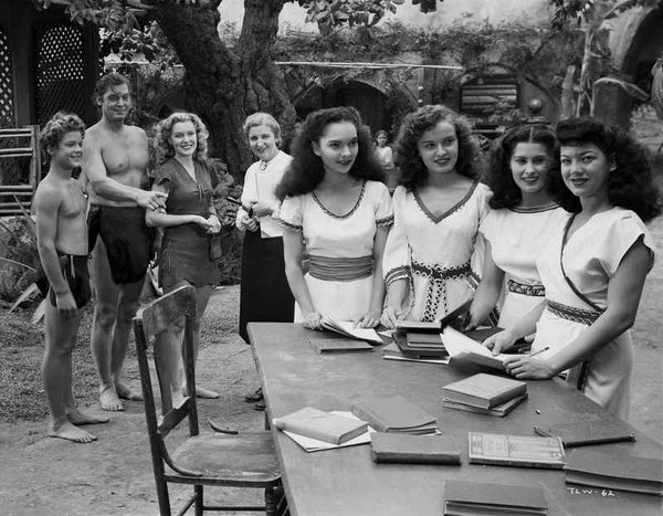 Johnny Weissmuller Looking to a Group of Women in a Classic Movie Scene Premium Art Print