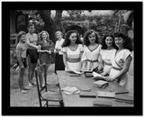 Johnny Weissmuller Looking to a Group of Women in a Classic Movie Scene High Quality Photo