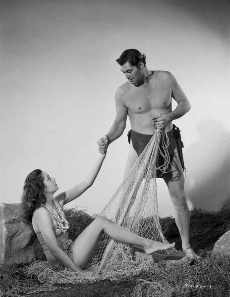 Johnny Weissmuller Helping a Woman in a Classic Movie Scene Premium Art Print