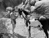 Johnny Weissmuller Feeding His Horse in a Classic Movie Scene Premium Art Print