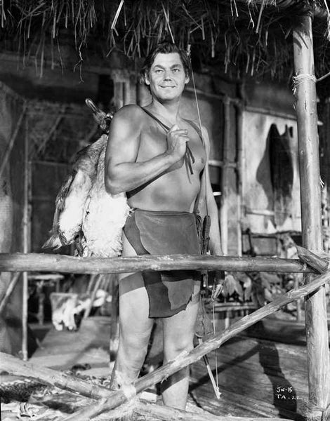 Johnny Weissmuller Carrying a Dead Animal in His Back in a Classic Movie Scene Premium Art Print