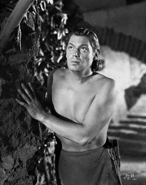 Johnny Weissmuller Hiding Behind a Rock Wall in a Portrait Premium Art Print