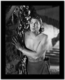Johnny Weissmuller Hiding Behind a Rock Wall in a Portrait High Quality Photo