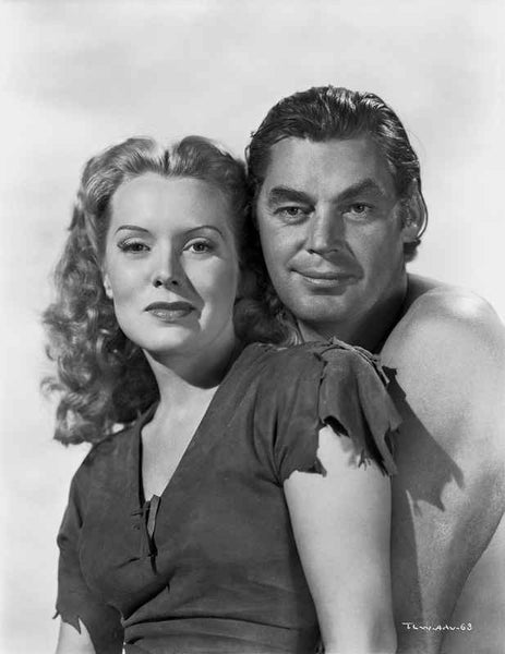 Johnny Weissmuller standing Behind a Woman in a Portrait Premium Art Print
