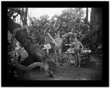 Johnny Weissmuller Helping a Woman to Get Down the Tree in a Movie Scene High Quality Photo